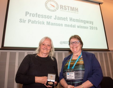 Profesor Janet Hemingway (left) receives the Manson Medal from Professor Sarah Rowland-Jones, then RSTMH President
