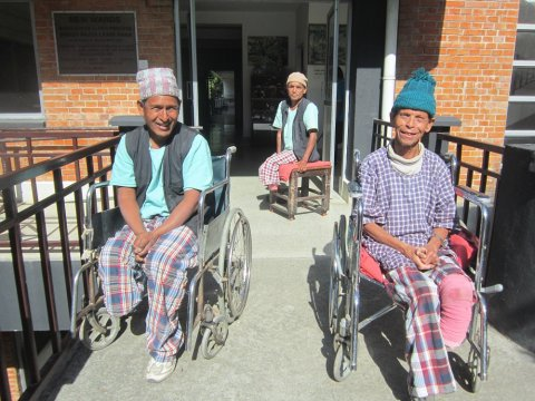 Patients enjoy the winter sun outside TLMN's Anandaban Hospital Leprosy Ward. Amputated feet highlight delayed diagnosis and the continued need for contact survey, self-care and awareness raising. © Tom Bradley/The Leprosy Mission Nepal (TLMN)