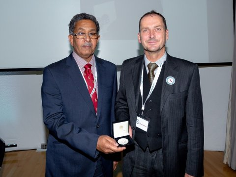 Professor Fahal receiving his award from Simon Cathcart, RSTMH Past President