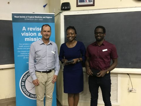 Dr Yvonne Wekesa (centre) and Dr Owachi Darius (right) receive prizes for best poster and oral presentation respectively from RSTMH Past President, Dr Simon Cathcart